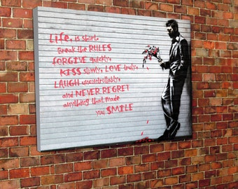 Banksy man with bouquet canvas print. Cool Canvas Design