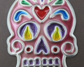 Sugar skull ornament or wall decoration. Day of the Dead skull ornament or wall decoration. Pink sugar skull ornament or wall decoration