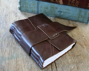 "Leather Journal . Isaac Asimov quote: ""Writing, to me, is simply thinking through my fingers"". handbound handmade . plum brown  (320 pgs)"