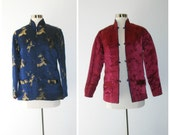 60s Asian jacket, reversible jacket in midnight blue and maroon silk. Blue side features gold metallic dragon print. Size M.
