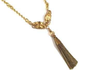 Gold chain tassel necklace with lilypad and water lily detail