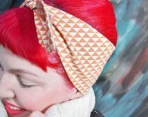 Rockabilly/Vintage/Pinup inspired 50s head scarf, dolly bow/bandana. ALEXANDER HENRY skull fabric, orange/white check