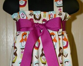 Little Matryoshka Zadee Dress.. Magenta, orange, aqua and dark brown...Girls Jumper