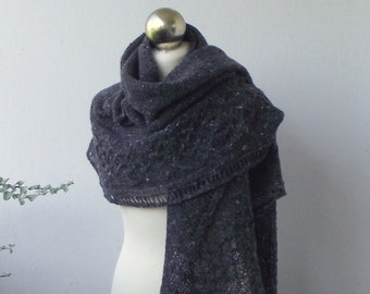 hand knitted crescent shawl with celtic cable pattern