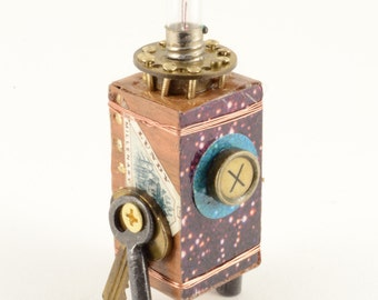 Illumination:   Original Mixed Media Assemblage Sculpture, brass, brown, and ivory by Leslee Lukosh of Foundturtle in Portland, Oregon