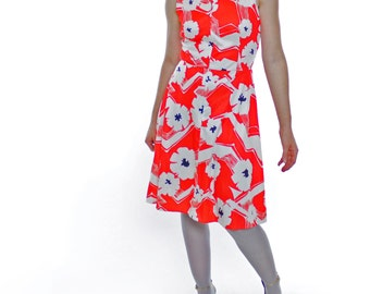 Vintage 60's sleeveless dress, bright red/orange with white & black floral pattern, zip neck, attached belt ties - Kay Windsor, Medium