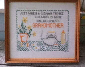 """Sampler Vintage Framed Cross Stitch Sampler Just When a Woman Thinks her work is done She Becomes a Grandmother measures 11 x 10"""""""