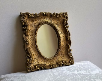 Vintage Ornate Gold Wall Mirror, Faux Carved Wood With Fleur de Lis Flourishes, Hollywood Regency Glam
