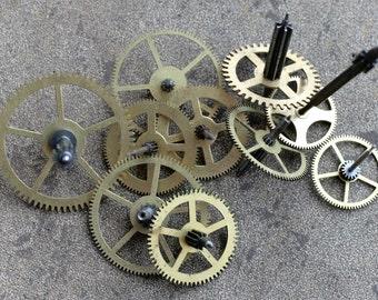 Vintage clock brass gears -- set of 10 -- D11