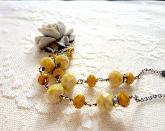 Large matte grey rose necklace with mustard yellow bead and rhinestone accents, Between Sun and Shadow