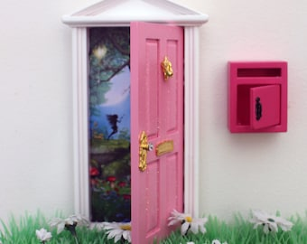Opening pink magical Fairy door with pink mail box