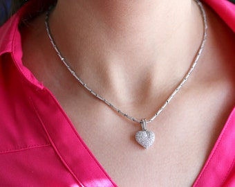 18k white gold diamond heart pendent.