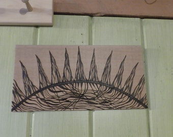 Sun with connecting rays  pyrography on cedar one of a kind sign made to order