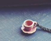 Back in stock - little tea party necklace in pink.