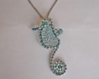 Wire wrapped sea glass seahorse pendant - unique sea glass seahorse.