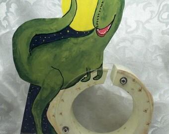 Green dinosaur sitting on dinosaur egg wooden bank-free personalization