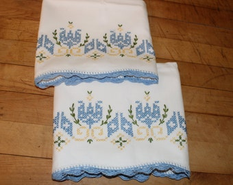 Vintage pillowcase embroidered with blue and yellow tulips