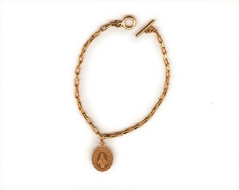 Miraculous Medal gold-plated on a gold plated bracelet, 7-3/4 inches, with toggle clasp