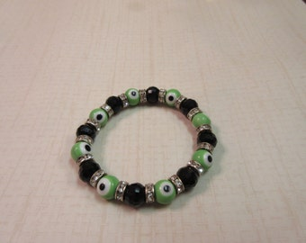 Beautiful Black and Lime green evil eye bracelet.