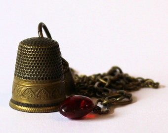 Acorn and Thimble Peter Pan and Wendy Necklace Hidden Kisses in Brass