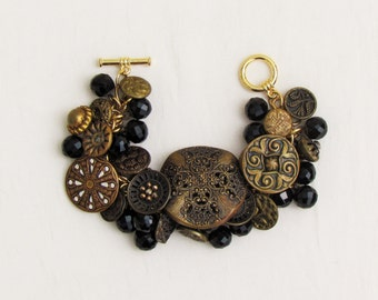 Handmade button bracelet made with Victorian brass and black glass buttons, bracelet made with antique buttons