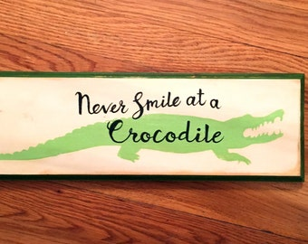 Never Smile at a Crocodile hand painted distressed wooden Peter Pan sign