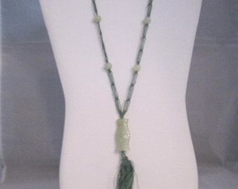 Carved Jade on knotted silk necklace