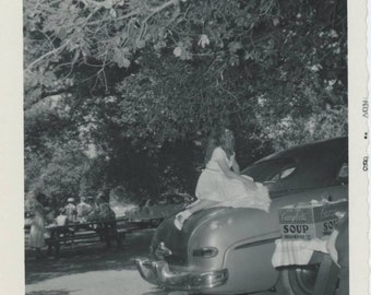 Ringlet Hair Girl on Trunk of Car at Picnic,  Vintage Snapshot Photo (512442)