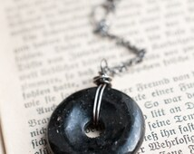 Nuummite pendant, gemstone donut, sterling silver, wire wrapped, black gemstone, Sorcerers stone, Magick talisman, gender neutral amulet