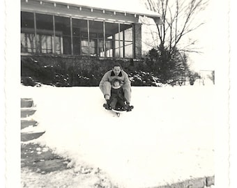 1949 Snapshot-Kurts Turn to Take Cindy Sledding