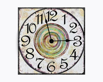 Clean and crisp, distressed white clock with aqua blue and green rings in the center. Square Design.