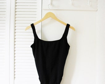 Hi-cut one piece black maillot, swimsuit. Size S.