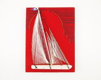 String Art Sailboat on Red Felt Backdrop - Brass Tacks - Black & Silver Thread - White Wood Hull - Artwork - White and Blue Flag - Sailboat
