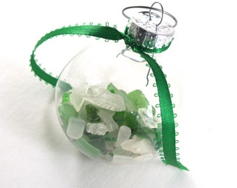 "Rhode Island White and Green Sea Glass Filled Clear Plastic 2"" Round Christmas Ornament with Green Ribbon and a Decorative Swirl Hook"