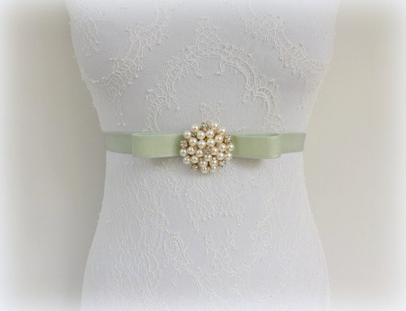 Mint green bow belt. Elastic waist belt. Gold rhinetone flower centerpiece decorated with Ivory pearls. Bridal dress belt.
