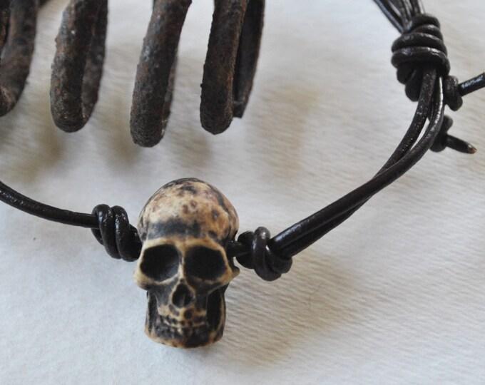 Men's skull bracelet on leather, adjustable, rugged, masculine