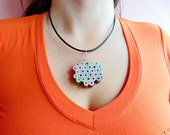 Flower shaped rainbow colored pencil crayon necklace pendant with brig...