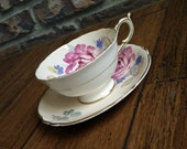 Antique Paragon bright white and soft peach tea cup and saucer set with floral design, scalloped edges, paragon tea set, english bone china