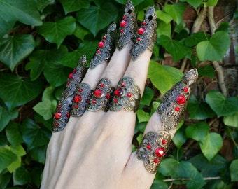 Red rhinestones claw spike filigree nail fingers
