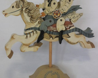 Lillian Renko Bledow handpainted and carved wooden carousel horse and wedding couple, signed '83