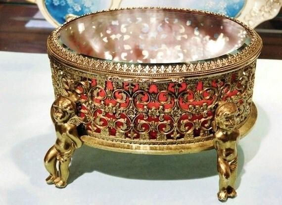 1940s Jewelry Casket Box Hollywood Regency Cherubs Filigree Ormolu Red Velvet Beveled Crystal 24 Karat Gold Plated Oval Box Vanity Boudoir