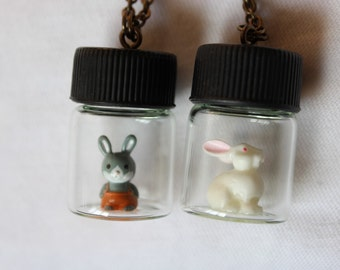 Necklaces vial, rabbit, white or grey