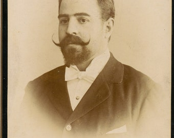 Cabinet Card of man with impressive handlebar mustache and beard