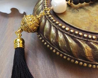 Long black beaded tassel necklace.Black tassel necklace. Long beaded tassel necklace. Black and gold beaded necklace with tassel.