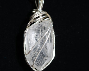 Quartz crystal, wrapped with silver parawire