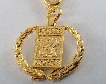 Vintage 1980's gold plated metal ROLLS ROYCE collectible emblem key chain new old stock