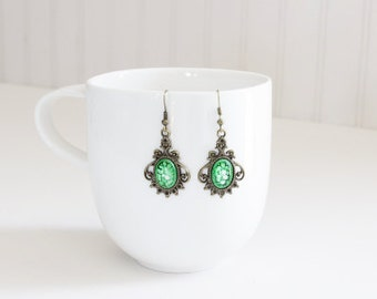Green Glass Cameo Earrings