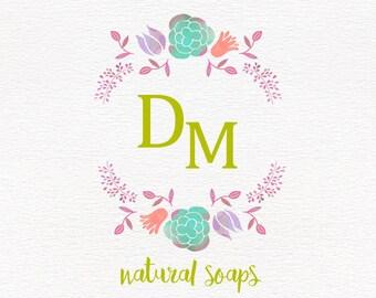 Round logo flower in pastel colors, feminine  design, soap logo, business branding