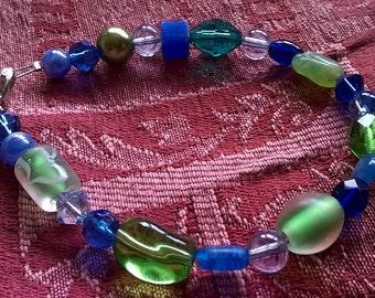Multi-bead, blues and greens bracelet.