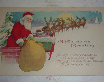 Santa Going Down the Chimney Witha Bag of Toys As Reindeer Wait Vintage Christmas Postcard